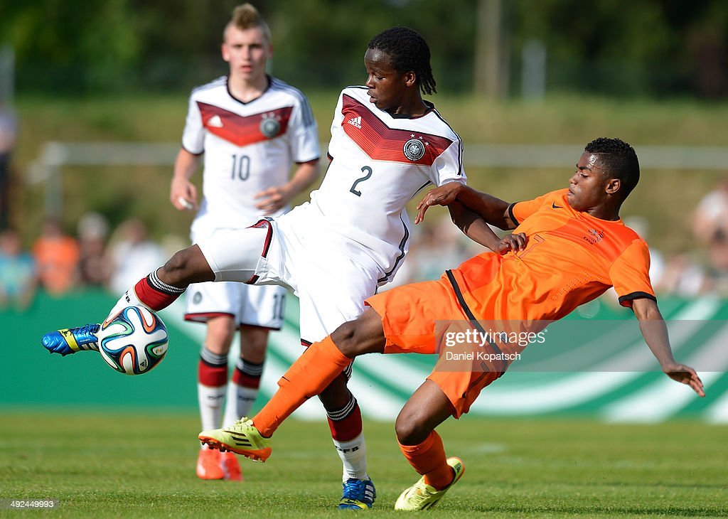 Alfons Amade of Germany (L) is challenged by Che Nunnely of the Netherlands during the international friendly U15 match between Germany and Netherlands on May 20, 2014 in Weingarten, Germany.