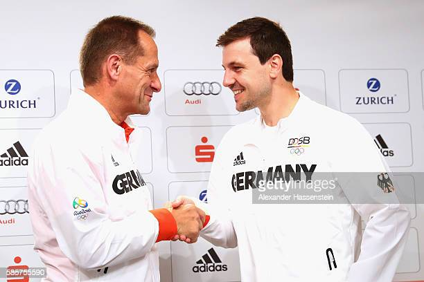 Alfons Hoermann president of the German Sports Confederation shake hands with table tennis player Timo Boll as he is announced as flag bearer for the...