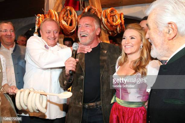 Alfons Schuhbeck Arnold Schwarzenegger Heather Milligan during the 28th Weisswurstparty at Hotel Stanglwirt on January 25 2019 in Going near...