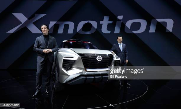 Alfonso Albaisa Nissan Senior Vice President for Global Design and Jose Munoz Chief Performance Officer pose with the new Nissan Xmotion crossover...