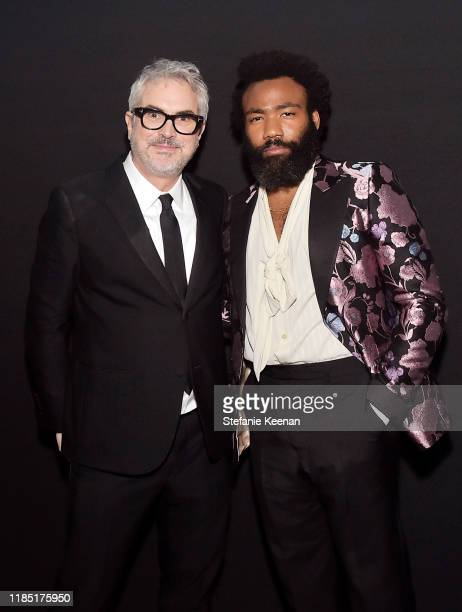 Alfonso Cuarón and Donald Glover both wearing Gucci attend the 2019 LACMA Art Film Gala Presented By Gucci at LACMA on November 02 2019 in Los...