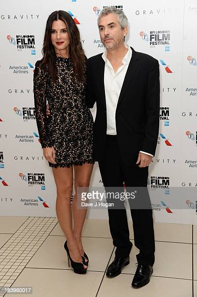 Alfonso Cuarón and Sandra Bullock attend the premiere of 'Gravity' during the 57th BFI London Film Festival at The Odeon Leicester Square on October...