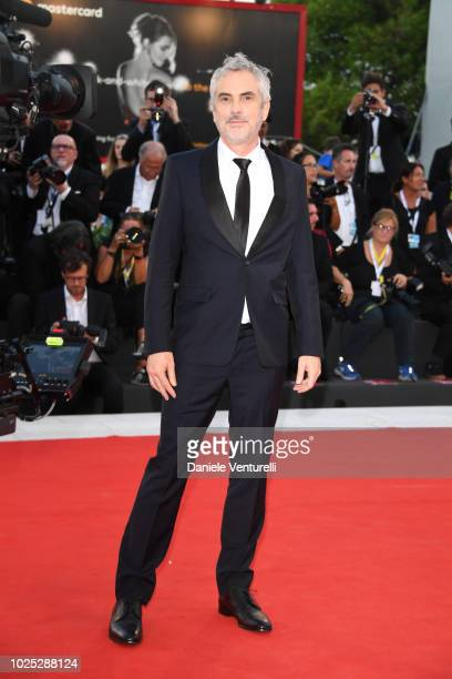 Alfonso Cuarón walks the red carpet ahead of the 'Roma' screening during the 75th Venice Film Festival at Sala Grande on August 30 2018 in Venice...