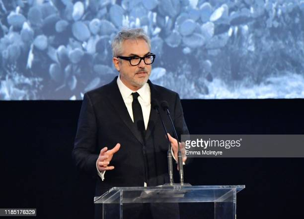 Alfonso Cuarón wearing Gucci speaks onstage during the 2019 LACMA Art Film Gala Presented By Gucci at LACMA on November 02 2019 in Los Angeles...