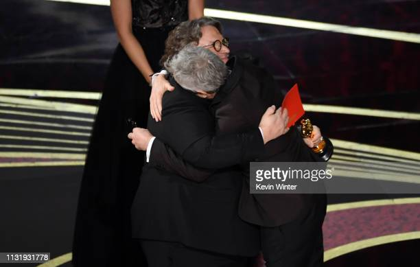Alfonso Cuaron accepts the Best Director award for 'Roma' from Guillermo del Toro onstage during the 91st Annual Academy Awards at Dolby Theatre on...