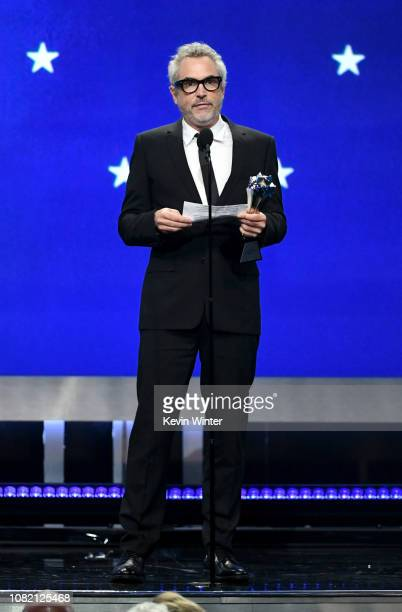 Alfonso Cuaron accepts the Best Director award for 'Roma' onstage during the 24th annual Critics' Choice Awards at Barker Hangar on January 13 2019...