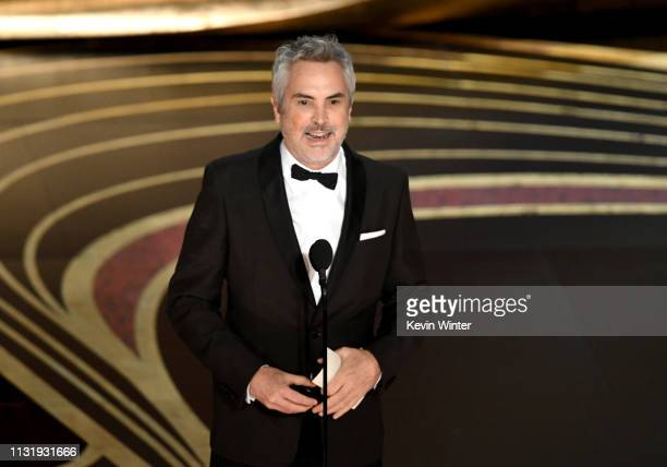 Alfonso Cuaron accepts the Best Director award for 'Roma' onstage during the 91st Annual Academy Awards at Dolby Theatre on February 24 2019 in...