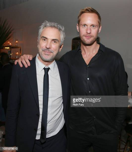 Alfonso Cuaron and Alexander Skarsgard attend the after party for the 'ROMA' red carpet premiere on September 10 2018 in Toronto Canada