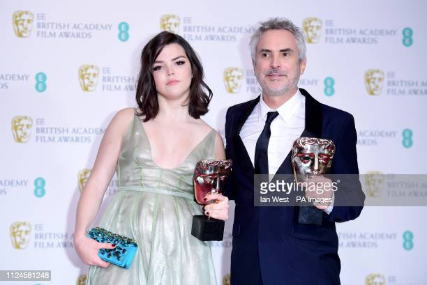 Alfonso Cuaron and Daughter Tess Bu Cuaron with his Best Film and Best Director Bafta's in the press room at the 72nd British Academy Film Awards...