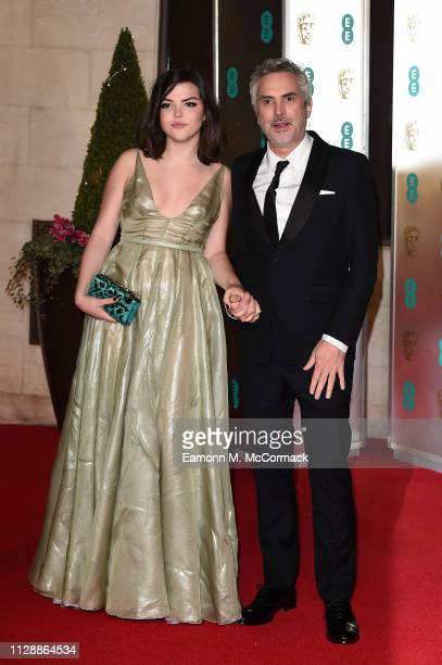 Alfonso Cuaron and his daughter Tess Bu Cuaron attend the EE British Academy Film Awards Gala Dinner at Grosvenor House on February 10 2019 in London...