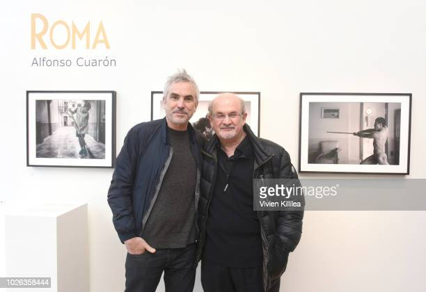 Alfonso Cuaron and Salman Rushdie attend the Roma photography exhibit at the Telluride Film Festival 2018 on September 2 2018 in Telluride Colorado