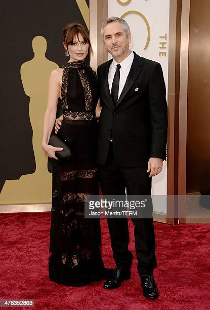 Alfonso Cuaron and Sheherazade Goldsmith attend the Oscars held at Hollywood Highland Center on March 2 2014 in Hollywood California