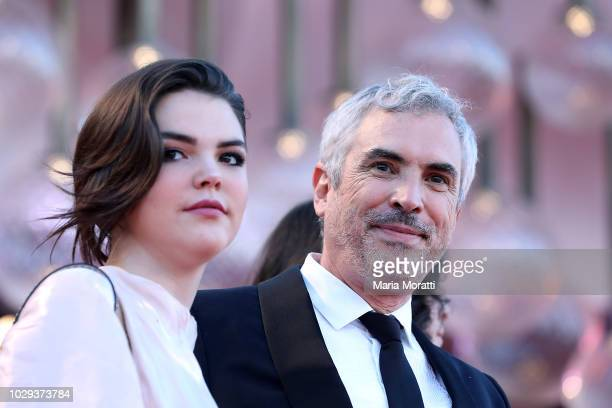 Alfonso Cuaron and Tess Bu Cuaron walk the red carpet ahead of the Award Ceremony during the 75th Venice Film Festival at Sala Grande on September 8...