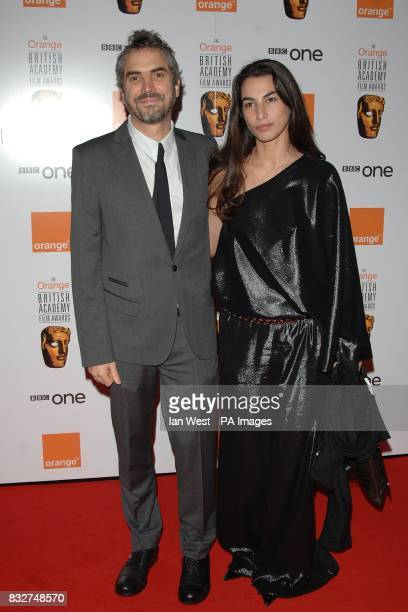 Alfonso Cuaron and wife Annalisa arrive for the 2007 Orange British Academy Film Awards at the Royal Opera House in Covent Garden central London