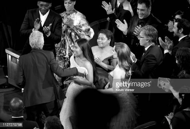 Alfonso Cuaron and Yalitza Aparicio react after Mr. Cuaron was announced as winner of the Cinematography award for 'Roma' onstage during the 91st...