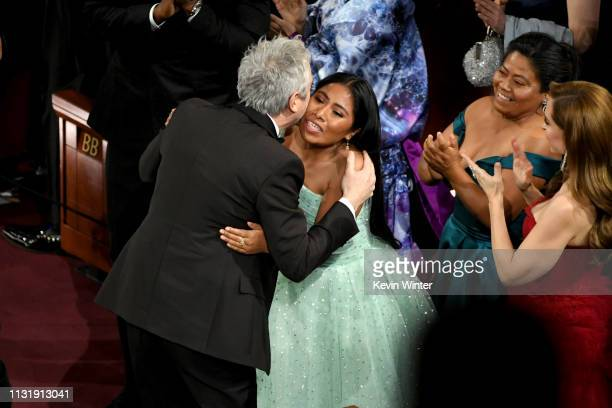 Alfonso Cuaron and Yalitza Aparicio react after Mr Cuaron was announced as winner of the Cinematography award for 'Roma' onstage during the 91st...