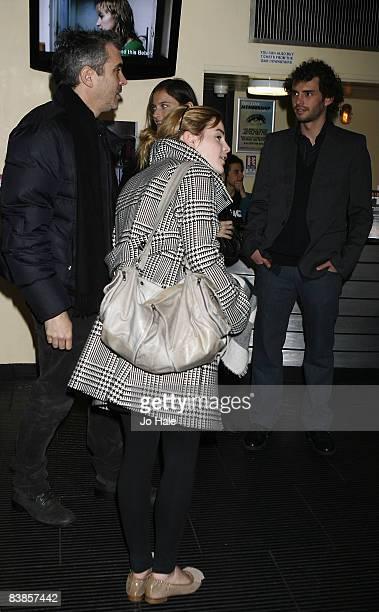Alfonso Cuaron Emma Watson and Jonas Curaron arrive at the UK premiere of Ano Una at Curzon Renoir Cinema on November 29 2008 in London England