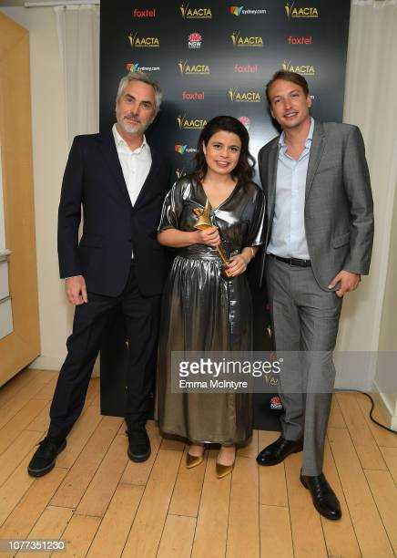 Alfonso Cuaron Gabriela Rodriguez and Nicolas Celis pose with the AACTA International Award for Best Film for Roma during the 8th AACTA International...
