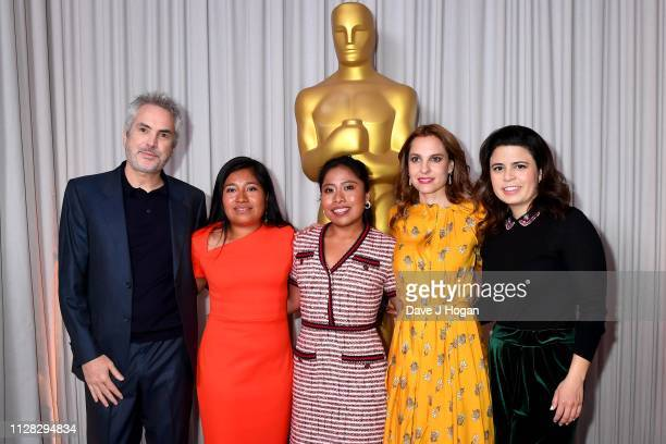 Alfonso Cuaron Nancy Garcia Garcia Yalitza Aparicio Marina de Tavira and Gabriela Rodriguez attend the 91st Oscars Nominee Champagne Tea Reception at...