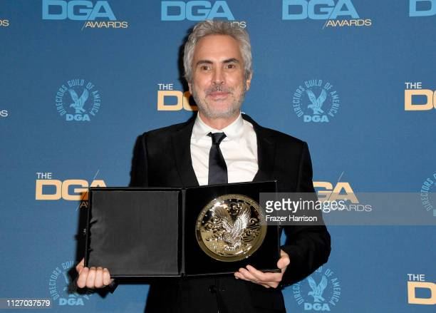 Alfonso Cuaron poses in the press room with the Feature Film Nomination Award for 'Roma' during the 71st Annual Directors Guild Of America Awards at...