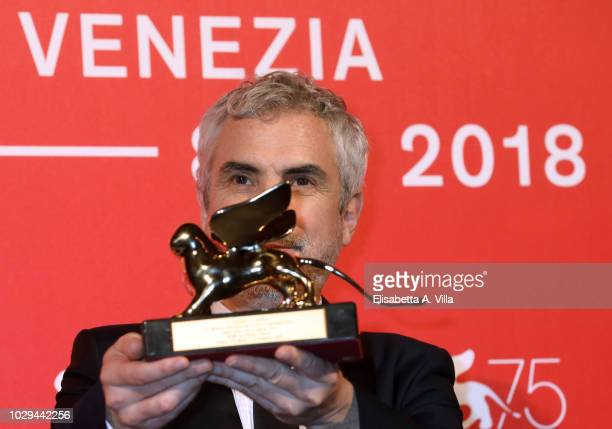 Alfonso Cuaron poses with Golden Lion for the best movie fo 'Roma' at the Winners Photocall during the 75th Venice Film Festival at Sala Grande on...