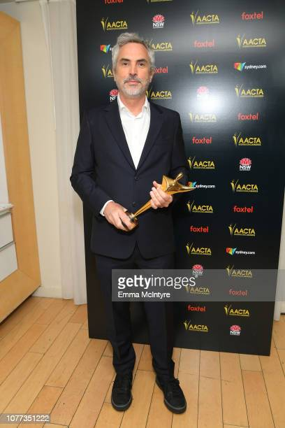 Alfonso Cuaron poses with the AACTA International Award for Best Direction during the 8th AACTA International Awards at Avalon Hollywood on January 4...