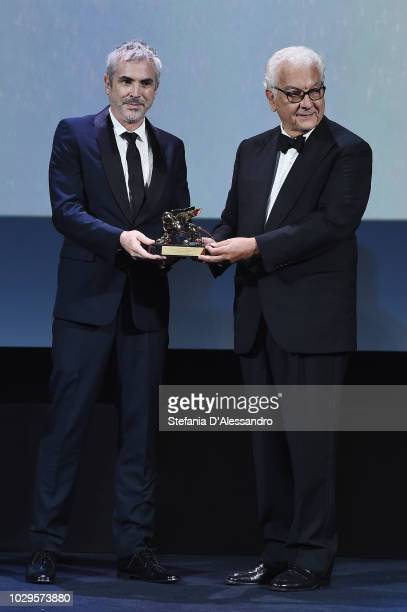 Alfonso Cuaron receives the Golden Lion Award for 'Roma' from Paolo Baratta at the Award Ceremony during the 75th Venice Film Festival at Sala Grande...