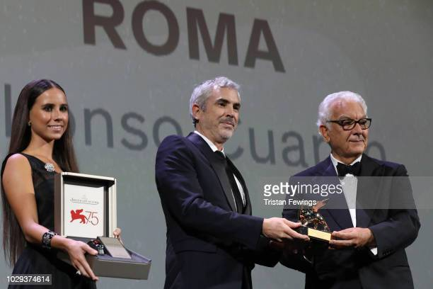 Alfonso Cuaron receives the Golden Lion for Best Film Award for 'Roma' from president of the festival Paolo Baratta at the Award Ceremony with a...