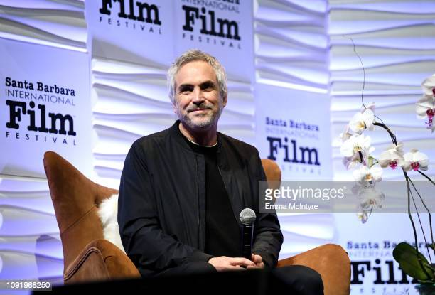 Alfonso Cuaron speaks onstage during the Outstanding Directors Award during the 34th Santa Barbara International Film Festival at Arlington Theatre...