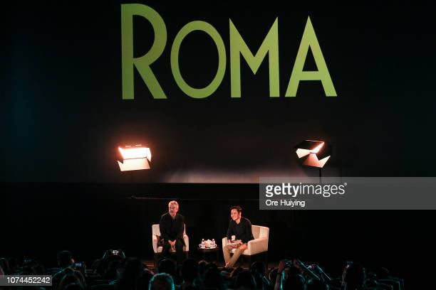 Alfonso Cuaron speaks with Boo Junfeng during the 'ROMA' Screening and Live Streaming QA event at Bugis Plus on December 20 2018 in Singapore
