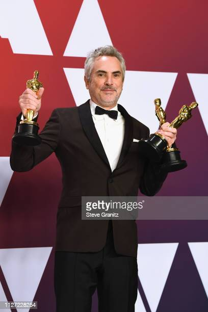 Alfonso Cuaron winner Best Director award Best Foreign Language Film award Best Cinematography award for 'Roma' poses in the press room during at...