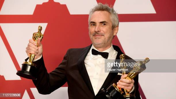 Alfonso Cuaron winner of Best Foreign Language Film Best Director and Best Cinematography for 'Roma' poses in the press room during the 91st Annual...
