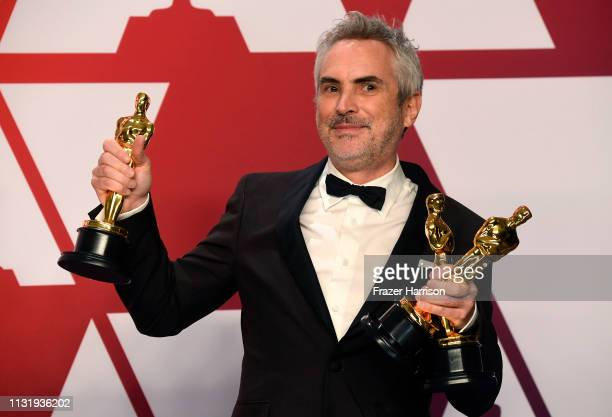 Alfonso Cuaron winner of Best Foreign Language Film Best Director and Best Cinematography for Roma poses in the press room during the 91st Annual...