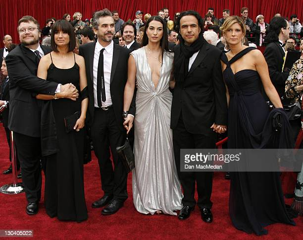 Alfonso Cuaron with wife Annalisa Bugliani Director Alejandro Gonzalez Inarritu and wife Maria Eladia and Director Guillermo del Toro with wife
