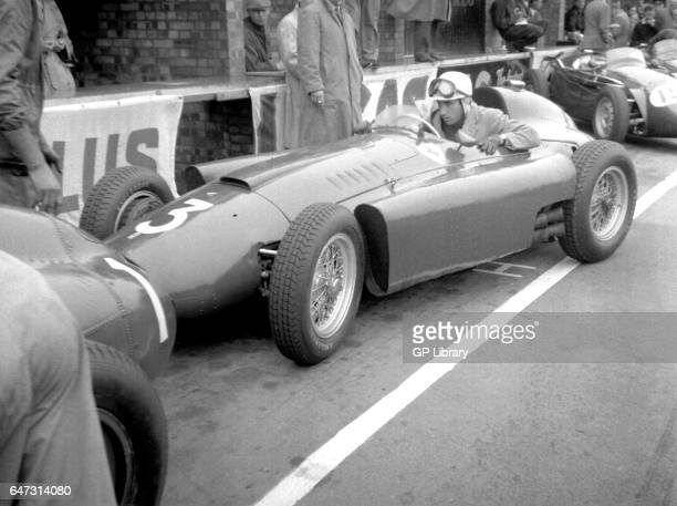 Alfonso de Portago in a lancia ferrari in the pits at the British Grand Prix 1956