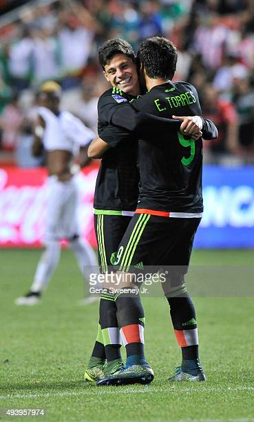 Alfonso Gonzalez and Erick Torres of Mexico celebrate their 20 win over Honduras after the final CONCACAF Olympic Qualifying match at Rio Tinto...
