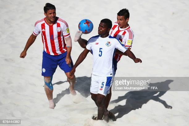 Alfonso Maquensi of Panama battles for the ball with Orlando Zayas and Luis Ojeda of Paraguay during the FIFA Beach Soccer World Cup Bahamas 2017...