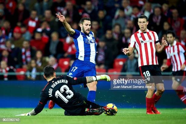 Alfonso Pedraza of Deportivo Alaves competes for the ball with Iago Herrerin of Athletic Club during the La Liga match between Athletic Club Bilbao...
