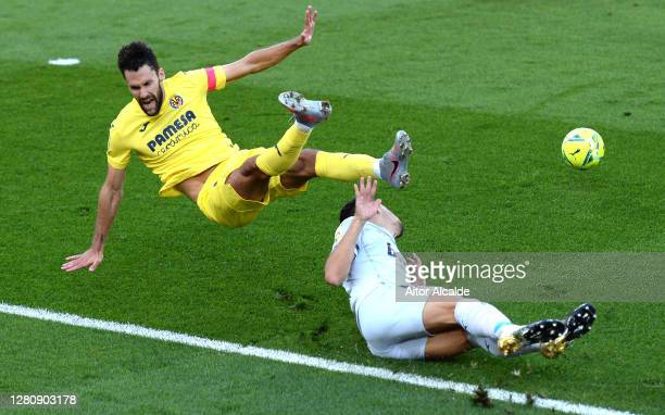 Alfonso Pedraza of Villarreal CF is fouled by Gabriel Paulista of Valencia CF leading to Villarreal CF being awarded a penalty during the La Liga...