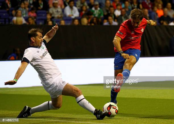 Alfonso Perez of Spain is tackled by Jackie McNamara of Scotland during the Star Sixe's match between Spain and Scotland at The O2 Arena on July 15...