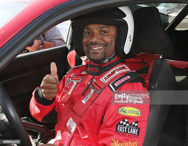 Alfonso Ribeiro gives a thumbs up to photographers during the 38th Annual Toyota Pro/Celebrity Race Press Day at the Toyota Grand Prix of Long Beach...