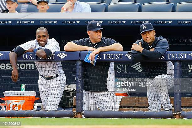 Alfonso Soriano Kevin Youkilis and Derek Jeter of the New York Yankees look on in the first inning against the Tampa Bay Rays at Yankee Stadium on...