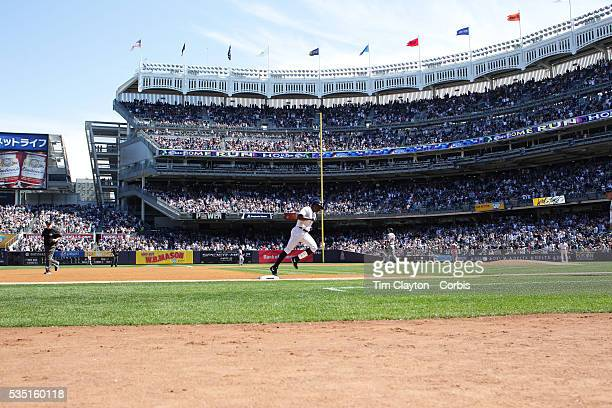 Alfonso Soriano New York Yankees rounds third base after his solo home run in the fourth inning during the New York Yankees V Boston Red Sox baseball...