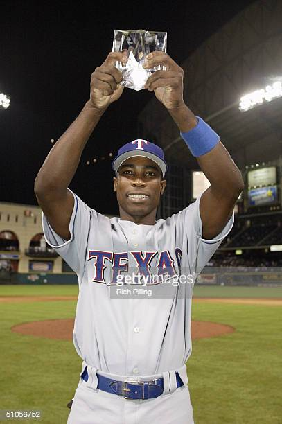 Alfonso Soriano of the American League team is awarded the Ted Williams MVP trophy after defeating the National League team 94 in the Major League...