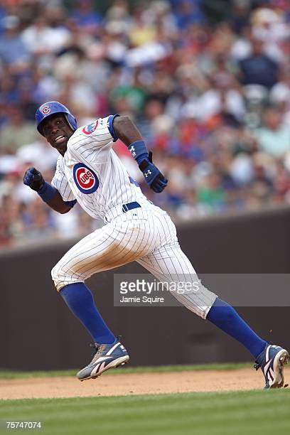 Alfonso Soriano of the Chicago Cubs advances to third base on a ground out by Mark DeRosa in the bottom of the fourth inning against the San...