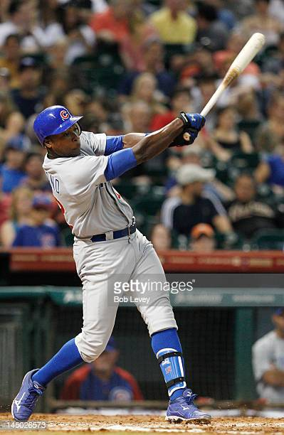 Alfonso Soriano of the Chicago Cubs drives the ball to deep center for a home run in the fourth inning against the Houston Astros at Minute Maid Park...