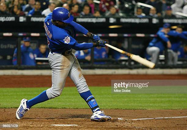 Alfonso Soriano of the Chicago Cubs follows through on a seventhinning home run against the New York Mets on April 21 2010 at Citi Field in the...