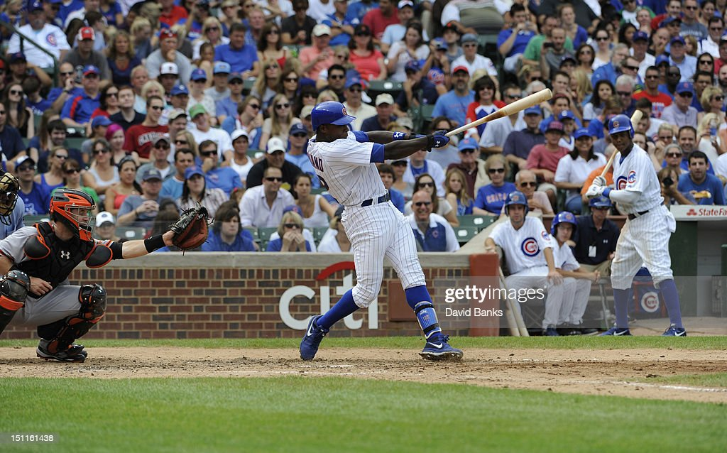 Alfonso Soriano #12 of the Chicago Cubs hits a three run homer in the fifth inning against the San Francisco Giants on September 02 2012 at Wrigley Field in Chicago, Illinois.
