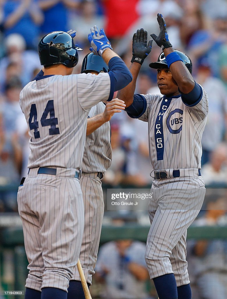 Alfonso Soriano #12 (R) of the Chicago Cubs is congratulated by Anthony Rizzo #44 and Nate Schierholtz #19 after hitting a two-run homer in the eleventh inning against the Seattle Mariners at Safeco Field on June 29, 2013 in Seattle, Washington.
