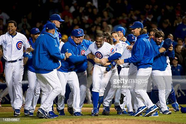 Alfonso Soriano of the Chicago Cubs is mobbed by his teammates after hitting a gamewinning RBI single scoring Tony Campana during the 10th inning...